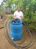 One of our beneficiaries with her irrigation equipment.