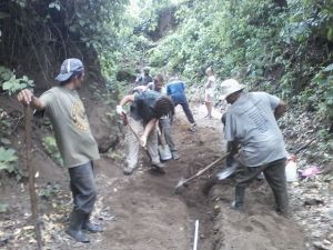 Volunteers and local people digging the channel for the  water pipes