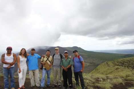 By horse or by foot – views of the live crater of the Masaya Volcano and, in the distance, the crater lake , Laguna de Masaya. L to R - Ariel, who leads the horses; Linda, group member; Franklin, local guide; Marlin, program coordinator; Nick, group member and photographer; Ismael, program coordinator and Bismark, local guide.