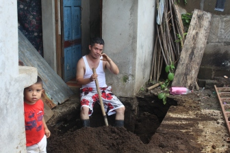 Jimmy surveying his collapsed septic tank