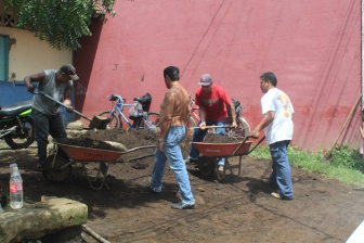 Mariposa workers helping to fill the septic tank