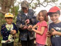 Releasing iguana back into the wild